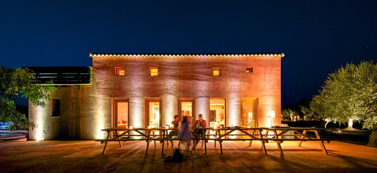 Eumelia Organic Agrotourism Farm & Guesthouse: Main building and dining area at night