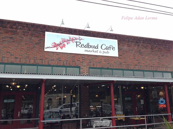 Front entrace to Redbud Cafe in Blanco with outddoor seating along front windows.