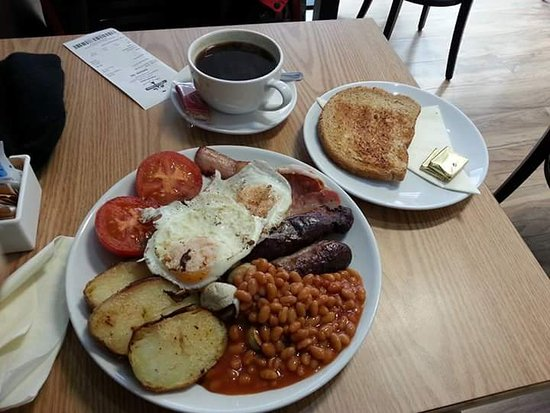 Teignmouth, UK: Megalicious All Day breakfast. Black pudding hidden under the eggs!