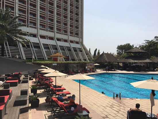 Transcorp Hilton Abuja: View of the most welcome pool area and view from the 5th floor room overlooking the city of Abuj