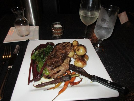 Parrsboro, Canada: Supper - Steak with carmalized onions, new roasted potatoes, beet greens, roasted rainbow carrot