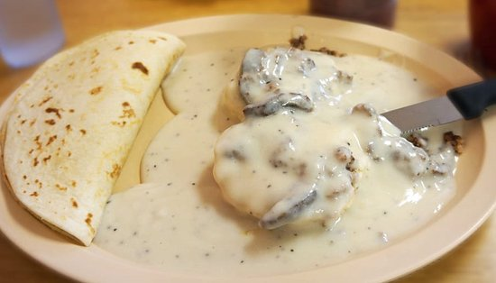 Taqueria Puerto Vallarta: Biscuits and Gravy w/ Sausage and a bean and cheese taco