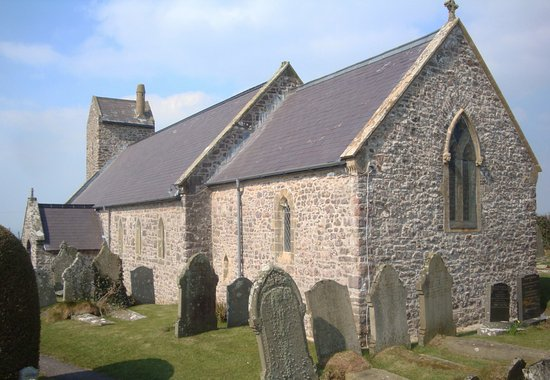Rhossili, UK: The chruch surrounded by graves