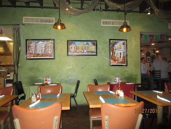Lola's : New Orleans prints on wall