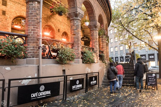 Cafe Cathedral Exterior With Cozy Outdoor Seating