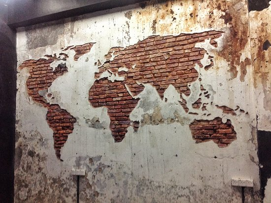 A world map carved into the wall Picture of Coffee Addict Cafe