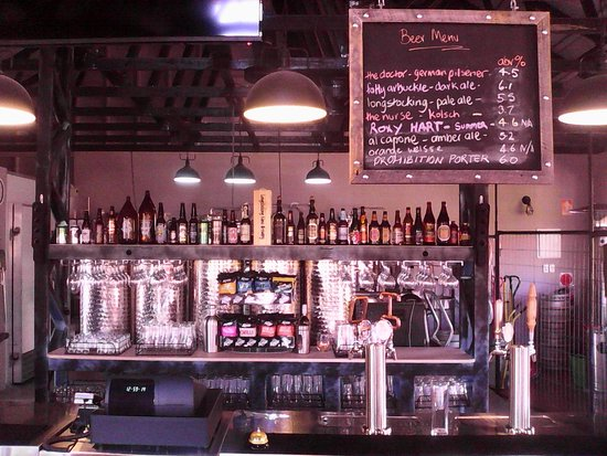 Longstocking Brewery: Photo of behind the Bar, with the beers on the Board on the RH side