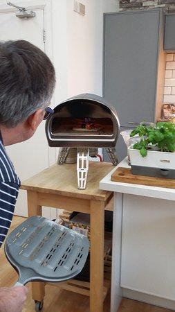 Penrith, UK: Hubby keeps an eye on his lunchtime pizza