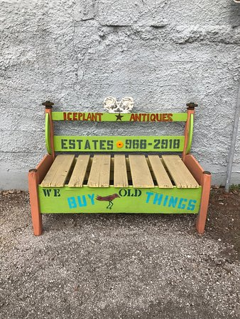 La Grange, TX: Bench in front of shop