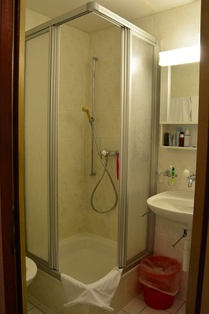 The little shower cubicle and toilet in my room - Picture of ...