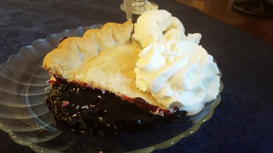 ... Black raspberry pie, warmed with vanilla ice cream and whipped cream