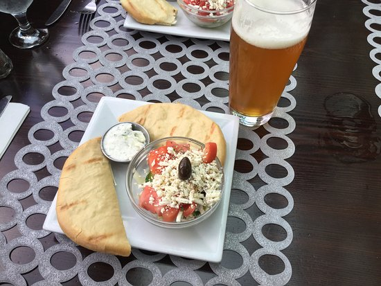 New Westminster, Canada: Starter - pita bread, tzatziki, Greek salad.
