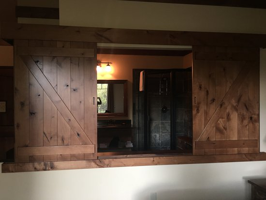 Lodge at Whitefish Lake: Barn doors open or close from bathroom to watch tv while soaking in tub.