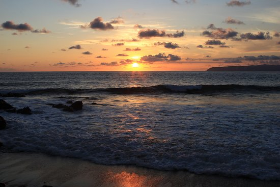 Pavones, Costa Rica: Beach sunset - just across the gravel road from the resort gate