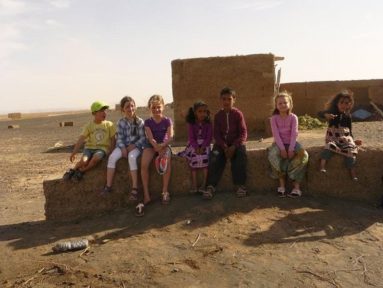 Hassane Merzouga Day Tours: children of locals with travelers children
