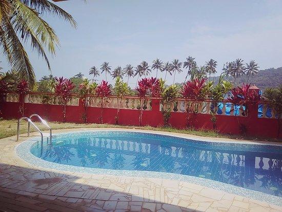 Simoes Residency : Poolside view