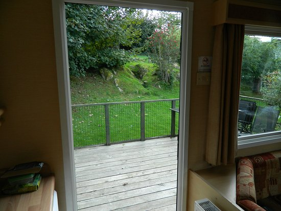 Kippford, UK: View from door to deck and yet more trees