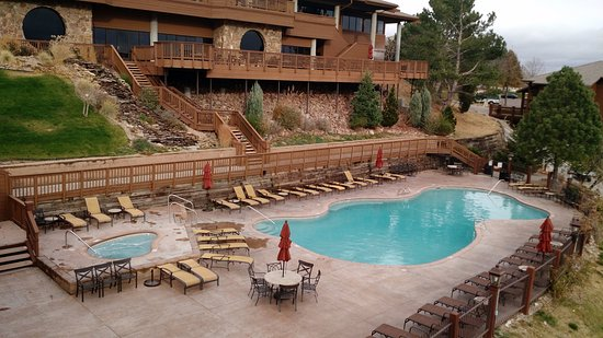 view of outdoor heated pool and jacuzzi picture of cheyenne