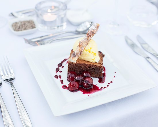 Elsenham, UK: Belgian chocolate brownie, brandy infused cherries & vanilla ice cream