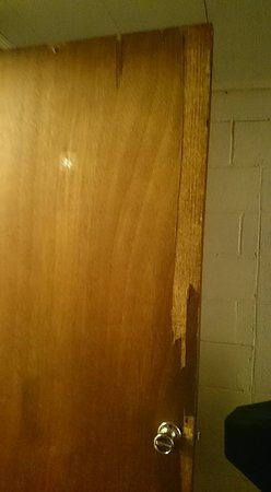 Jasper, AR: Door to bathroom cracked and split and parts of woodwork have been broken off