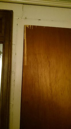 Jasper, AR: Peeling, cracking doors with veneer stripped off in places.