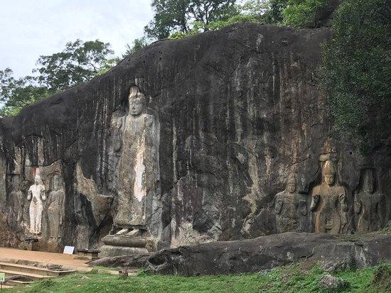 Uva Province, Sri Lanka: The seven statues in a rock. Ancient history of Sri Lanka in Mahayana Buddhism