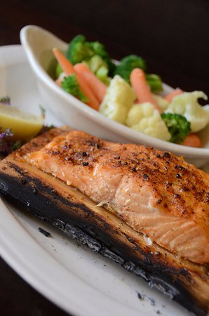 Clinton, IA: Salmon on a cedar plank with steamed veggies