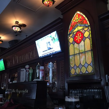 Playwright Irish Pub: Stained glass and etched wood makes the bar feel truly historic