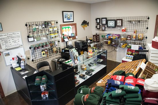 Grayling, MI: Fly Shop - open year round selling fly fishing equipment, apparel, snacks and beverages.