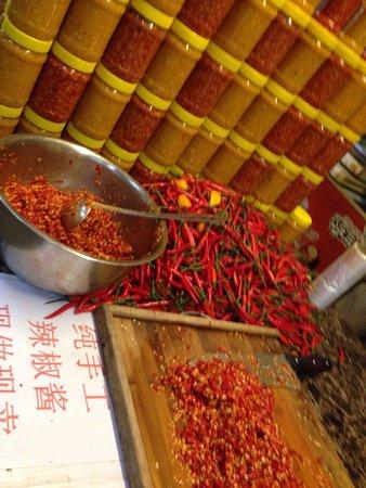 Sanya, China: Map, people. Show, market