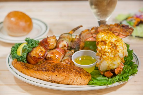 Marble Falls, TX: The Mixed Grill with lobster, bacon-wrapped shrimp, and the fresh catch of the day