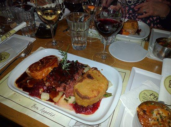 pb boulangerie bistro turkey dinner sweet potato gratin apricot sausage stuffing braised greens