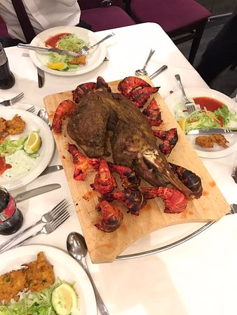 Sheldon, UK: Leg of lamb and king prawns. Specially for the graduation boy to carve and give out