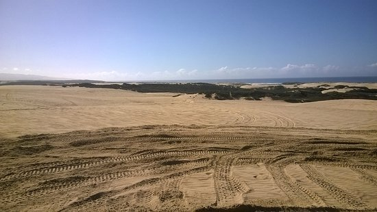 Grover Beach, Kalifornien: ATV riding on dunes along beach