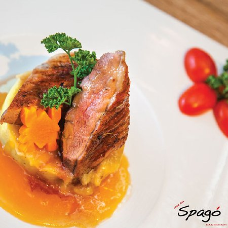 Spago' : Grilled duck in yellow mango sauce