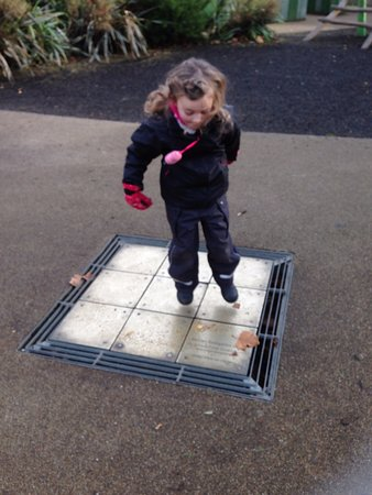 Diana Princess of Wales Memorial Playground: Making music while dancing! Each tile is a tone, so by jumping around you can play a tune...
