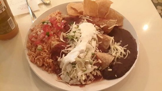 La Taqueria: Chicken Enchiladas in a roja sauce, with mexican rice, and blacks bean puree
