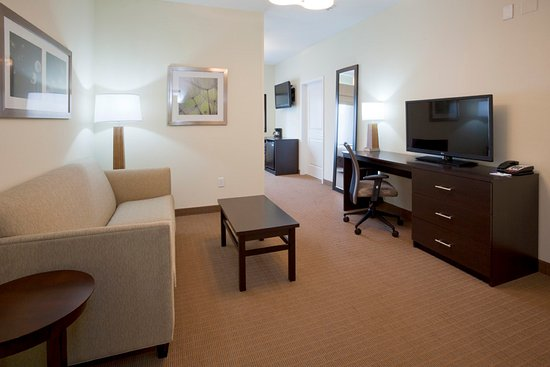 Rogers, MN: Hearing accessible king suite with pullout sofa.