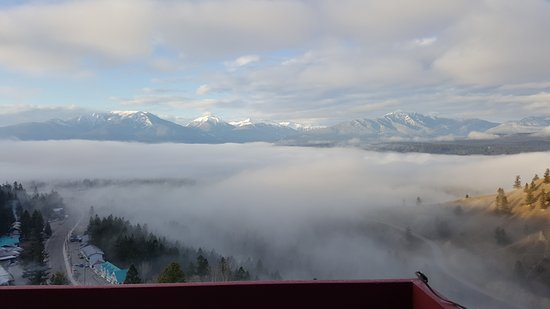 Radium Hot Springs, Canada: Breathtaking view of the fog rolling in...from the deck