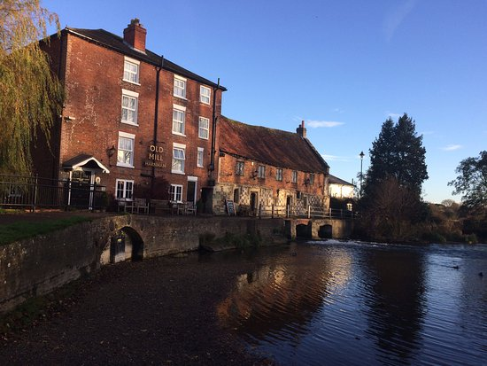 Harnham, UK: A view of the mill from the mill pond.