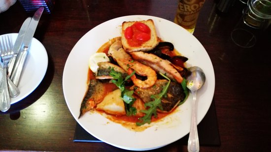 Emsworth, UK: Fish soup: Cod, Bream, Salmon, one King prawn, one scalp served with tomato bruschetta. Pictured