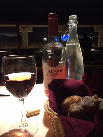 The Moonshadow Grille: Nice Bread assortment, Chilled Water and a Beringer White Zin