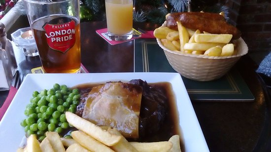 Emsworth, UK: Steak and ale pie and sausage and chips.