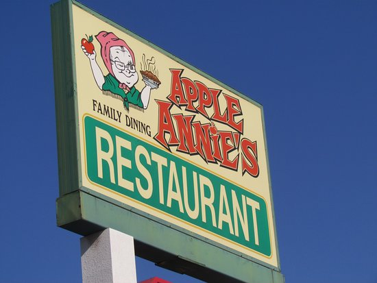 Road sign, Apple Annie's Restaurant, Tulare, California