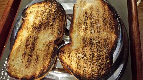 Milton Common, UK: Black burnt toast for room service breakfast. Staff argued that guests liked burnt toast!