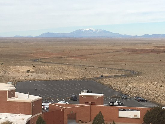 Winslow, AZ: Meteor crater and vast views of distant mountains.