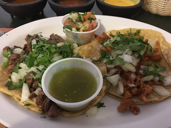 Zion, IL: Carne asada ( steak ) taco and al pastor ( pork ) taco. Beans and rice.