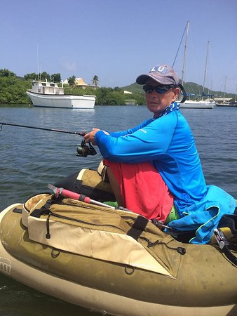 Fishing In Antigua With Captain Nick: Ali hooking huge Tarpon!
