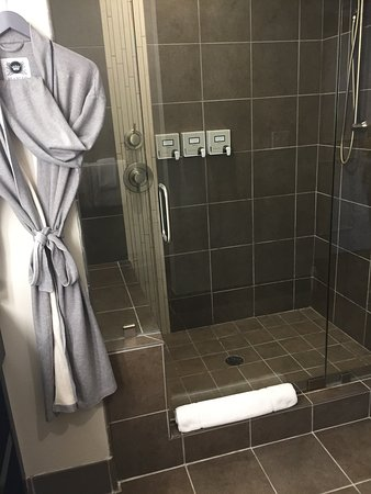 The Restoration: Large walk-in shower with courtesy bathrobes