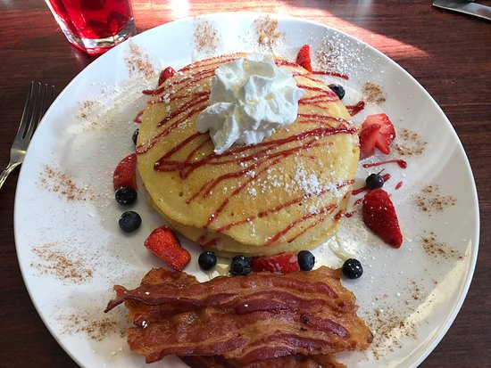 Hudson, MA: Side serving Loaded French Toast, #37 Huevo Rancheros, Loaded Pancakes with Side of perfect baco